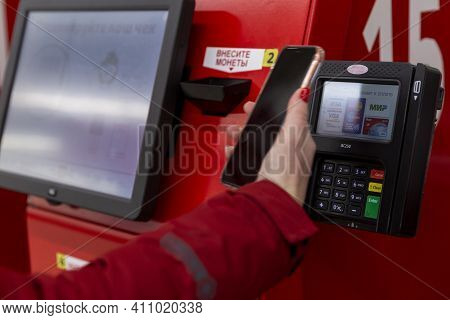 Pay For Purchases By Phone At A Self-service Checkout In A Supermarket. Close-up. Moscow, Russia, 03