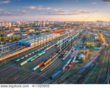 Aerial View Of Freight Trains At Sunset. Top View Of Railway Station, Wagons, Railroad. Heavy Indust