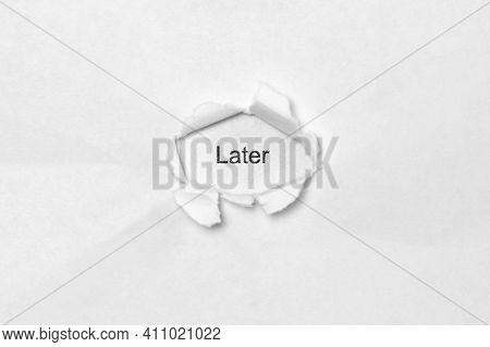 Word Later On White Isolated Background, The Inscription Through The Wound Hole In Paper. Concept Of