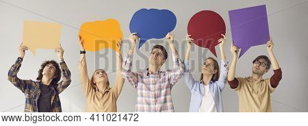 Group Of Young People Holding Colorful Mockup Speech Bubbles Sharing Their Own Opinions
