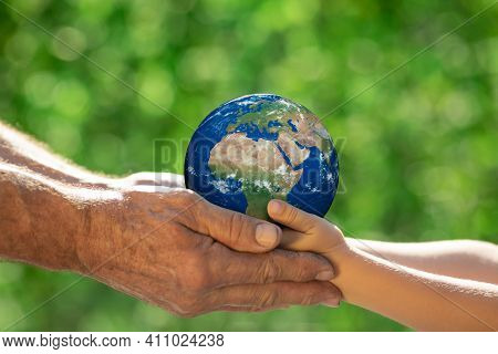 Family Holding Earth Planet In Hands. Elements Of This Image Furnished By Nasa