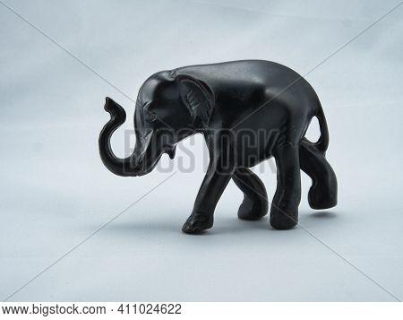 Black Ebony Statue Of Elephant On A White Background
