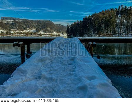 Photography Of A Frozen Lake Without Snow On A Sunny Icy Cold Winter Day In Switzerland