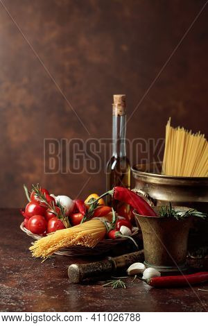 Pasta With Ingredients And Old Kitchen Utensils. Copy Space.
