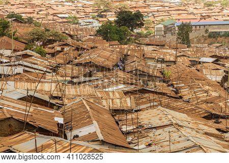 The Brown And Rusted Roof Tops Of Many Buildings In The Kibera Slum Of Nairobi, Kenya.