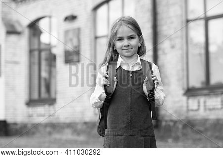 Small Kid In Formal Fashion Uniform Carry School Bag Outdoors, Schooling.