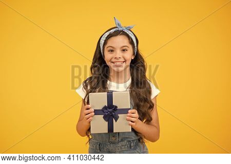 Surprise And Present Box. Child Smiling Happy Hold Gift Box. Kid Girl Delighted Gift. Childrens Day.