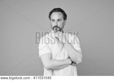 His Beard Works Well. Mature Man Touch Beard Hair Grey Background. Barbering And Grooming. Skincare.