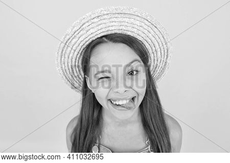 Happy Cheerful Kid In Summer Hat Yellow Background. Funny Grimace. Enjoying Vacation. Summer Fashion