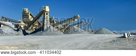 Quarry Machines And Piles Of Gravel Over Blue Sky. Stone Crushing And Screening Plant, Panoramic Vie