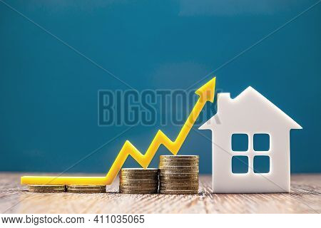 Real Estate Market, Graph, Up Arrow. House Model And A Stack Of Coins. The Concept Of Inflation, Eco