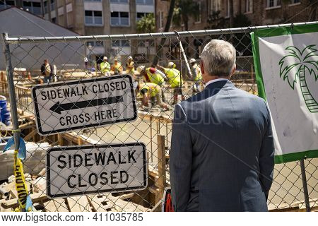 A Man Look At A Street Site Under Construction In Charleston, Sc