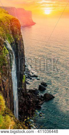 Kilt Rock and Mealt Falls, Isle of Skye, Scotland, Beautiful  Waterfall at sunset
