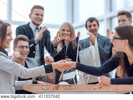 two business women confirming the deal with a handshake