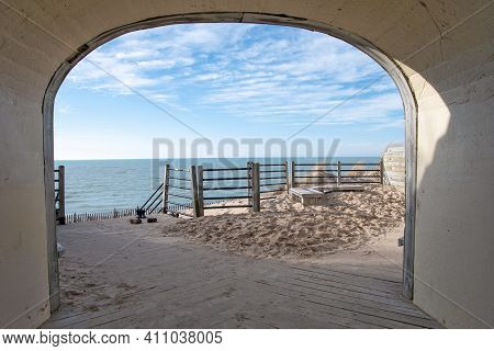 Concrete Tunnel On Sand Dune With Fence Overlooking Lake Michigan