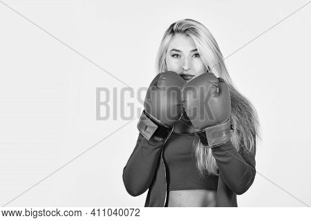 Confident Young Sportswoman Posing In Boxing Gloves. Beautiful Woman With Red Boxing Gloves. Young S