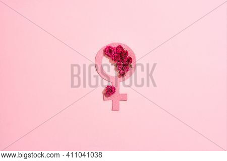 Female Gender Symbol Lying With Roses On A Pink Background. Gender Sign Symbol Lying In Roses For Ma