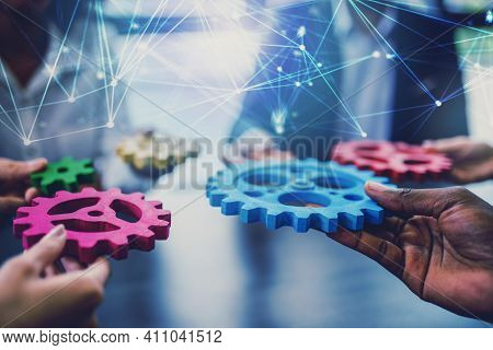 Group Of People Connect Single Colored Cogwheels To Make A Gear. Teamwork, Partnership And Integrati