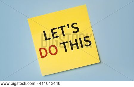 The Phrase Let's Do This In Red And Black Text On A Yellow Sticky Note Posted On A Blue Board