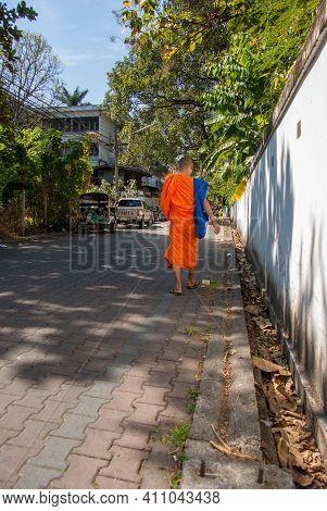 14.11.2011, Chiangmai, Thailand. A Monk Walks Along A Street In The Northern Thai City Of Chiangmai.