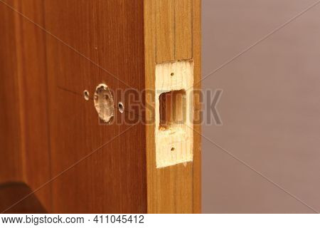 Close-up End Hole For Door Latch Inserting. Pencil Markup For Doorknob Installing .