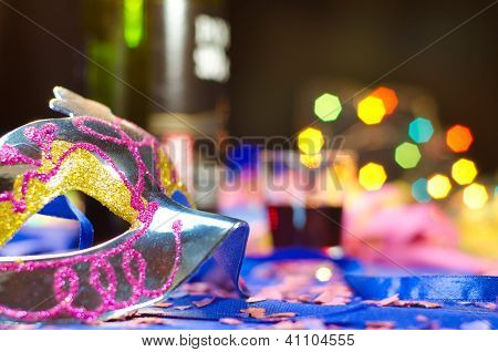 Carnival mask with a colorful background