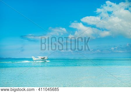 Seaplane Begins To Take Off On The Island Of Mauritius In The Indian Ocean