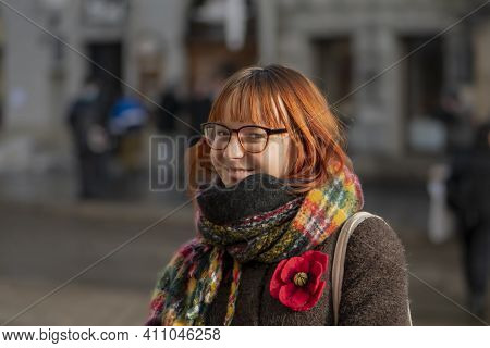 Laughing Young Woman 20-25 Years Old With Dyed Red Hair And A Little Overweight With Glasses On The
