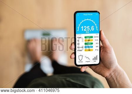 Woman Using Smart Weight Scale Measurement Tech