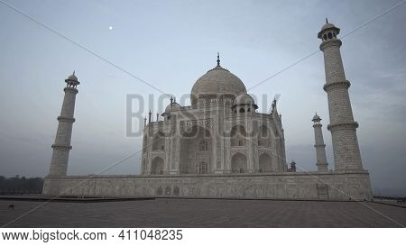 Agra, India - March, 26, 2019: Taj Mahal Illuminated By A Setting Moon In Agra
