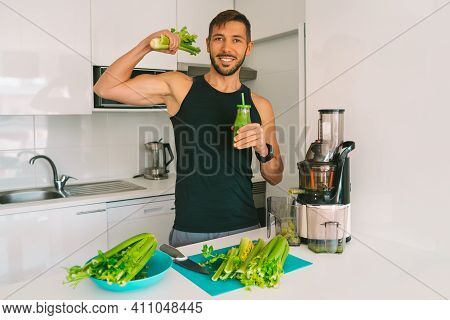 Attractive Athletic Active Sportive Man Making Fresh Detox Homemade Celery Juice In Juicer Machine A