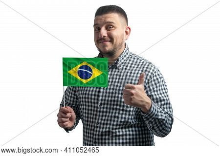 White Guy Holding A Flag Of Brazil And Shows The Class By Hand Isolated On A White Background. Like