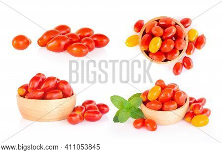 Set Of Cherry Tomatoes And Pepermint In Wood Bowl Isolated On White Background, Food Healhty Concept