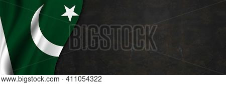 Pakistan Flag On Concrete Wall. Banner With Fabric Texture Of The Flag Of Pakistan.