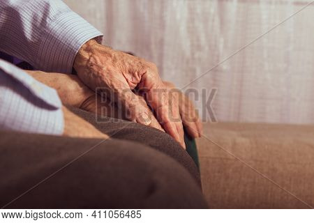 Elderly Care Concept. Elderly Wife Supporting During Disease. Aged Unrecognizable Couple Sitting On