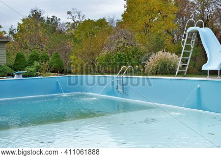 Backyard Swimming Pool With Diving Board Pool Slide And Ladder Emptied Out Shutting Down For Winter