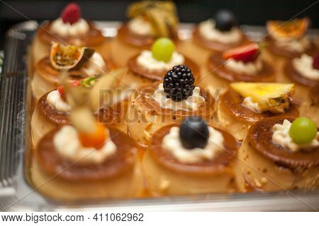 Desserts With Fruits, Mousse, Biscuits. Different Types Of Sweet Pastries, Small Colorful Sweet Cake