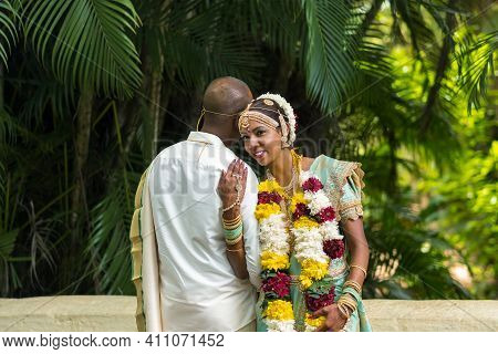 December 8, 2019.mauritius.the Bride And Groom In National Mauritian Outfits At The Botanical Garden