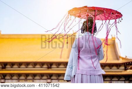 Back Side Of Cheerful Beautiful Asian Chinese Girl Wearing Traditional Chinese Dress With A Chinese