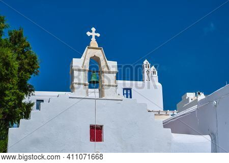 Typical Bell Tower Or Small Belfry Of A Whitewashed Greek Orthodox Church On A Clear Summer Day. Gre
