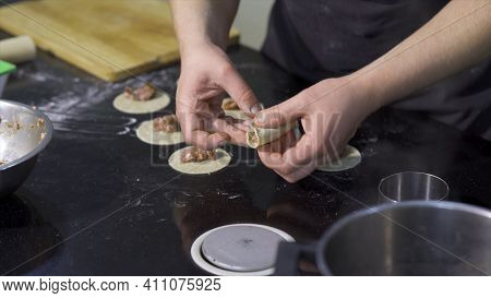 Close-up Of Cook Preparing Dumplings With Minced Meat. Art. Cooking Traditional Dumplings By Profess