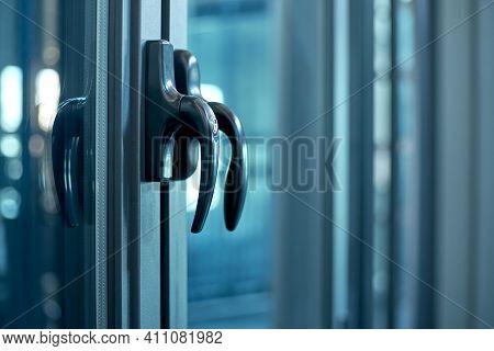 Close-up. Metal Handle On The Glass Door. Lock For Window Handle