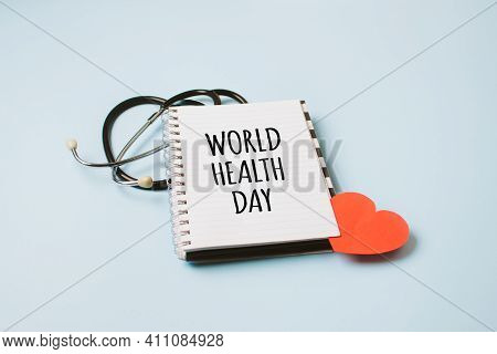 World Health Day, Medical And Healthcare. Stethoscope And Text World Health Day In Open Notepad On B