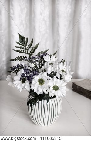 On The Table In A White Ceramic Vase Is A Bouquet Of Beautiful White Chrysanthemums. Front View, Cop