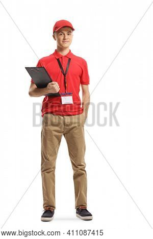 Full length portrait of a retail shop supervisor holding a clipboard isolated on white background