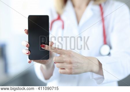 Doctor Pressing His Finger On Screen Of Mobile Phone Closeup. Doctor Call Concept