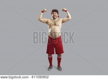 Happy Topless Man In Sports Shorts With Some Belly Fat Flexing Arms Showing His Muscles