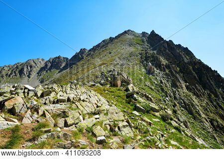 Mount Pic de Portarras in Neouvielle national nature reserve, department of Hautes-Pyrenees, Occitanie in south of France. Mountain landscape in sunny day.
