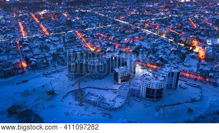 Low-rise Suburban Buildings, Drone View. Night Winter Cityscape.