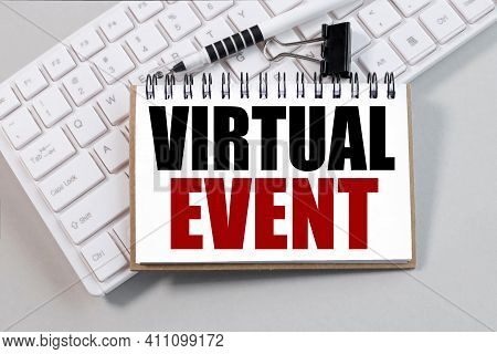 Virtual Event. Text On White Notepad Paper On White Keyboard